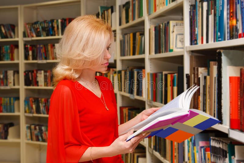 Download Woman in library stock image. Image of bookstore, young - 23430069
