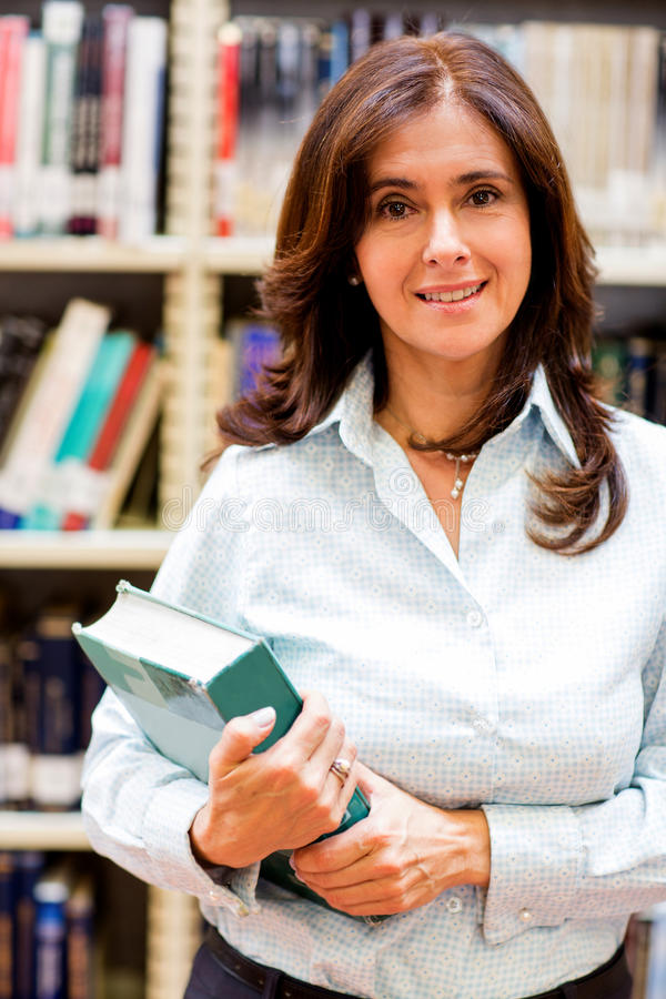 Download Woman at the library stock image. Image of joyful, read - 25493235