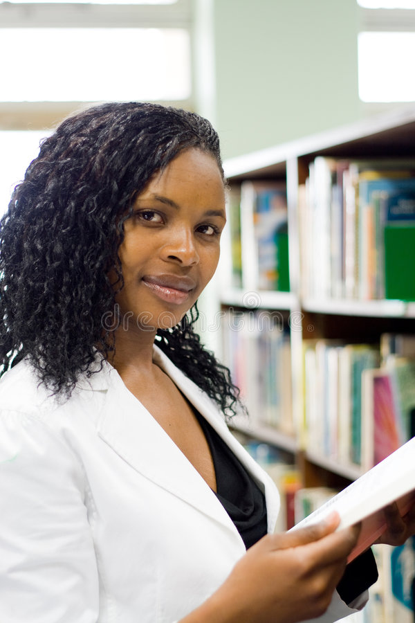 Woman in library stock images