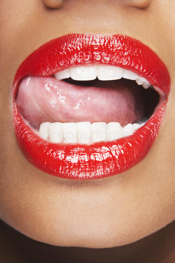 Woman Licking Red Lips royalty free stock photos