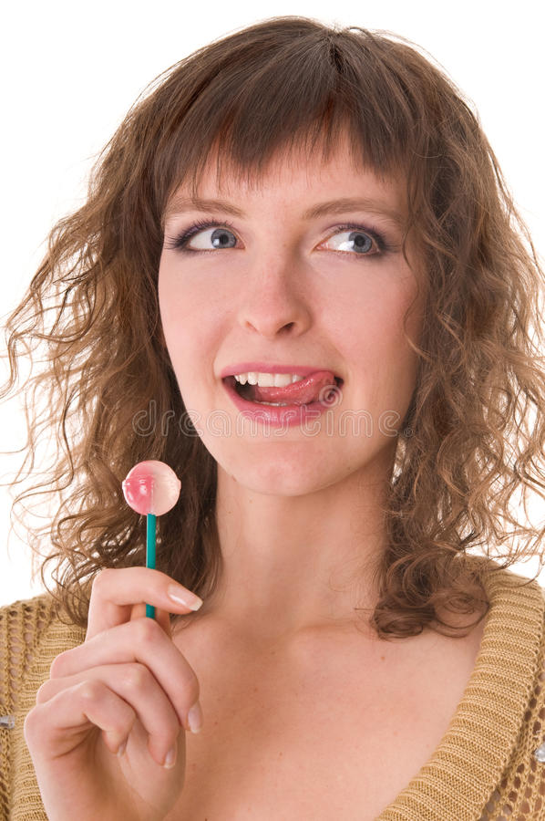 Woman licking sweet sugar candy. Closeup. Isolated on white royalty free stock photo