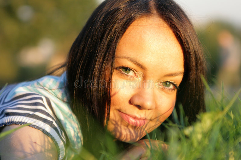 Download Woman Lie On The Grass Royalty Free Stock Photo - Image: 3318705