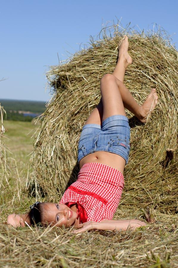 Download Woman lie near haystack stock image. Image of rest, grassland - 22455771