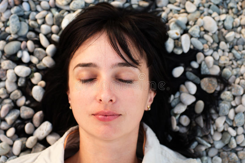 Download Woman Lie On The Stone Beach Stock Image - Image: 16421801