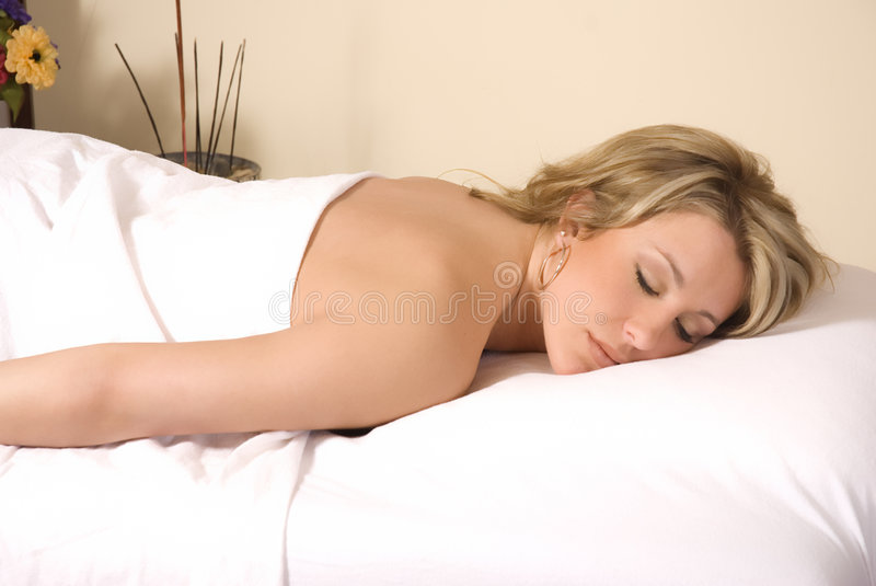 Woman lies prone royalty free stock photography