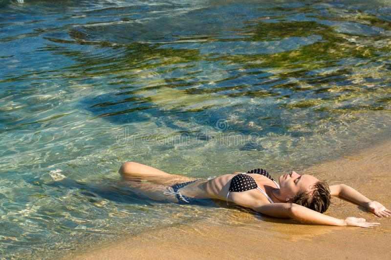 Woman lies in the water, top view royalty free stock photography