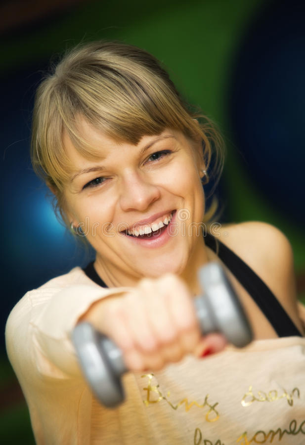 Woman Lifting Dumbbell Royalty Free Stock Photography