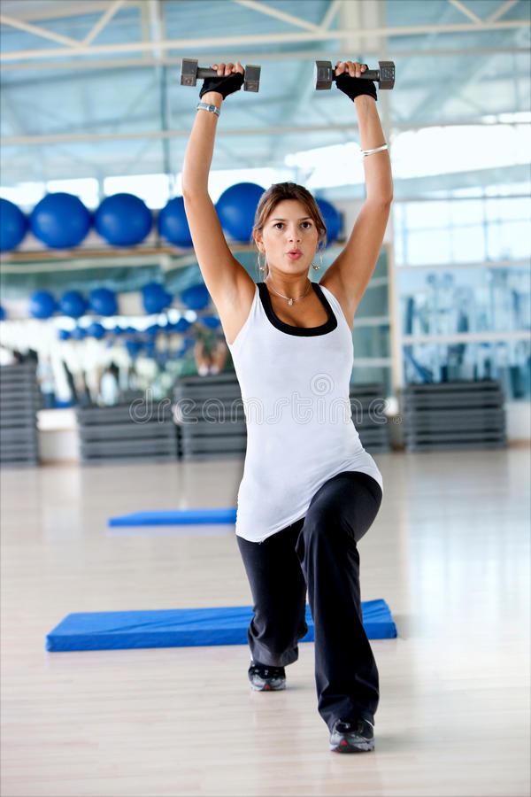 Download Woman lifting free weights stock image. Image of health - 12915597