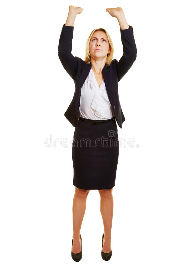 Woman lifting heavy imaginary object stock photography