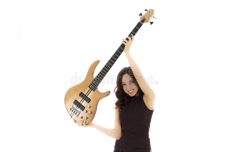 Woman lifting her bass guitar royalty free stock images