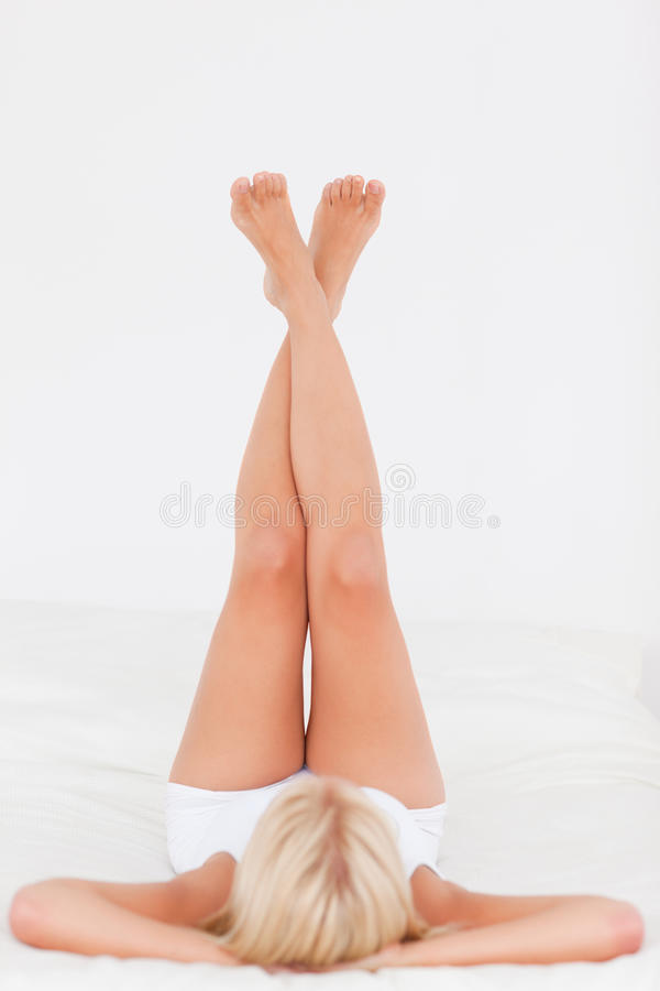 Woman lifting her legs up stock image