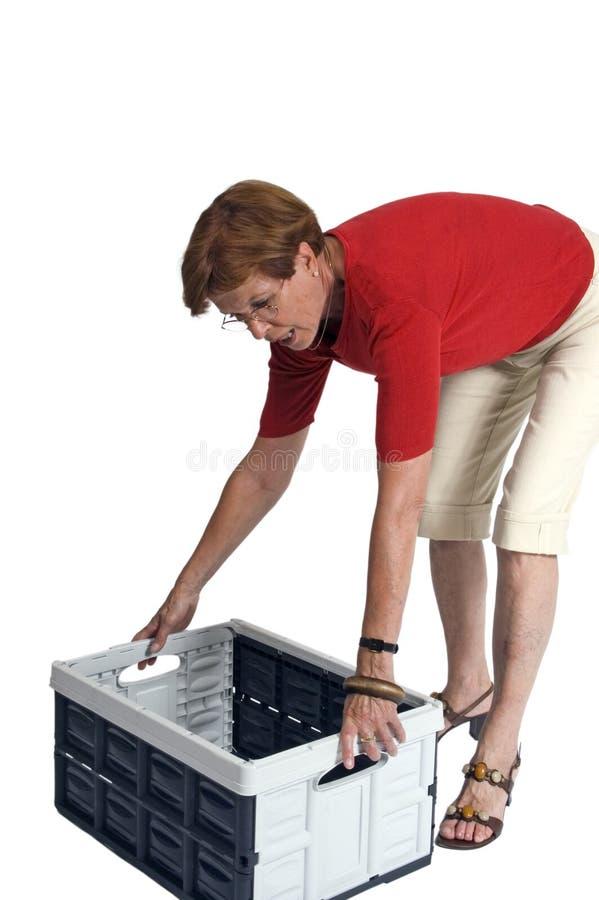 Woman lifting storage box royalty free stock images