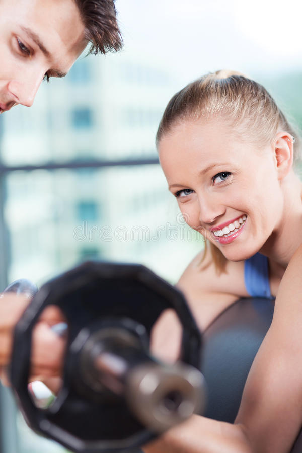 Woman lifting weights stock images