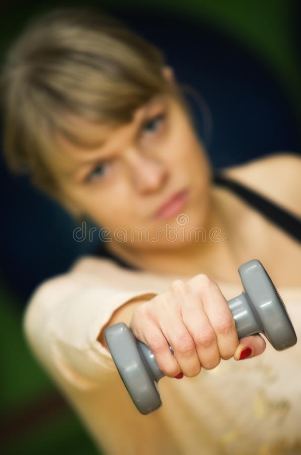Download Woman lifting weights stock image. Image of physical - 28696623