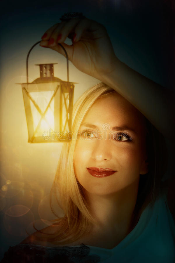 Woman with light lantern stock photo