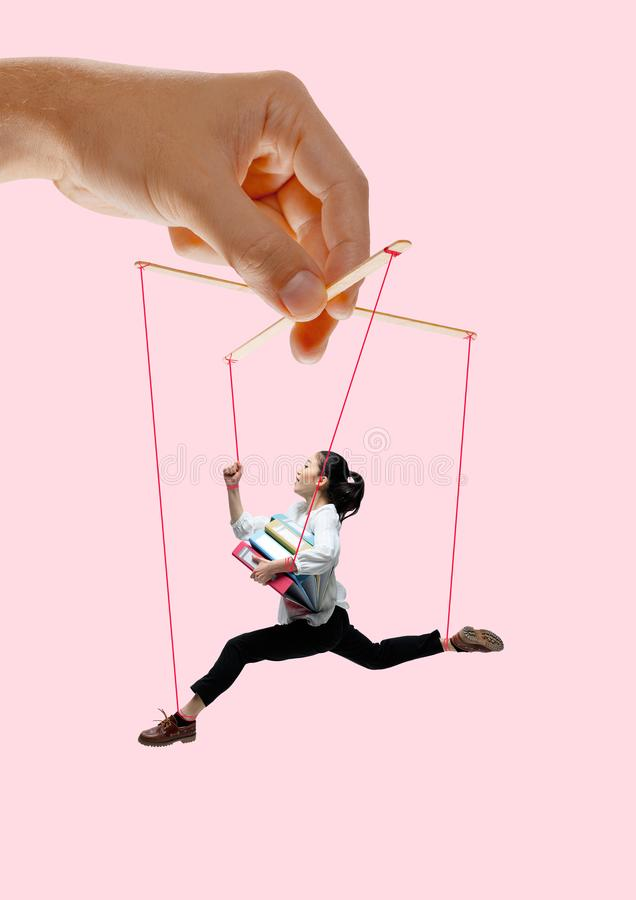 Woman like a puppet in somebodies hands. Concept of manipulation stock photography