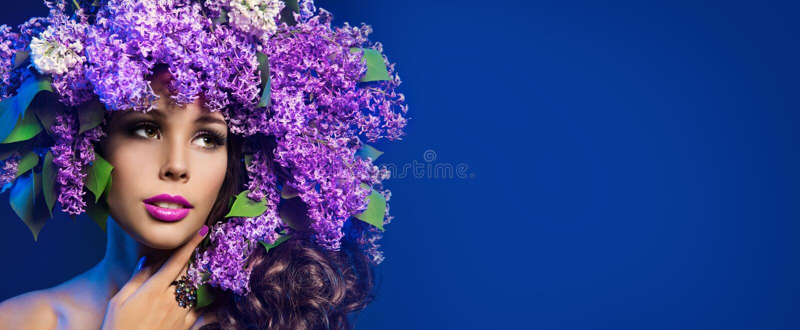 Woman Lilac Flower Wreath Hat, Beautiful Fashion Models with Purple Flowers in Hairstyle on Blue royalty free stock image