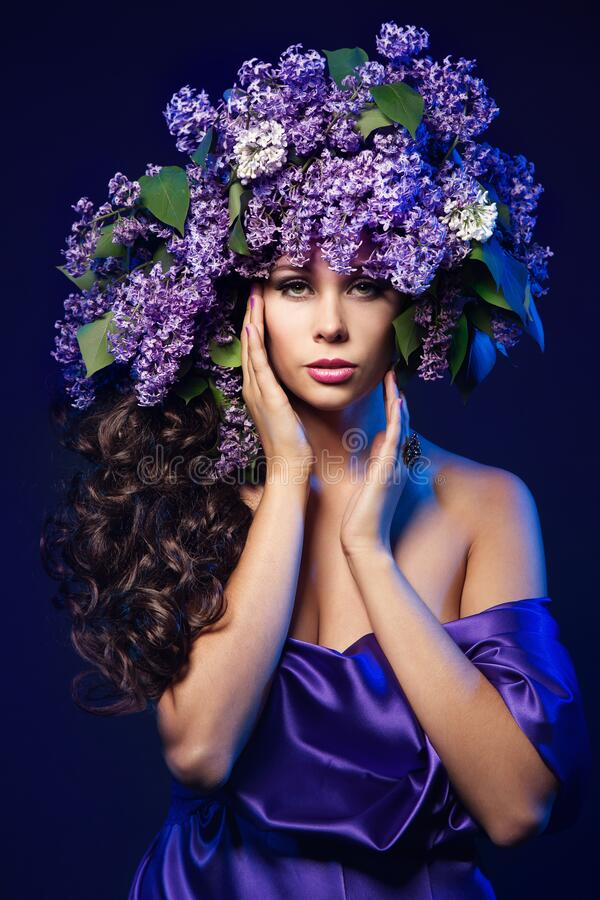 Woman Lilac Flower Wreath Hat, Beautiful Sexy Fashion Models with Purple Flowers in Hairstyle stock image