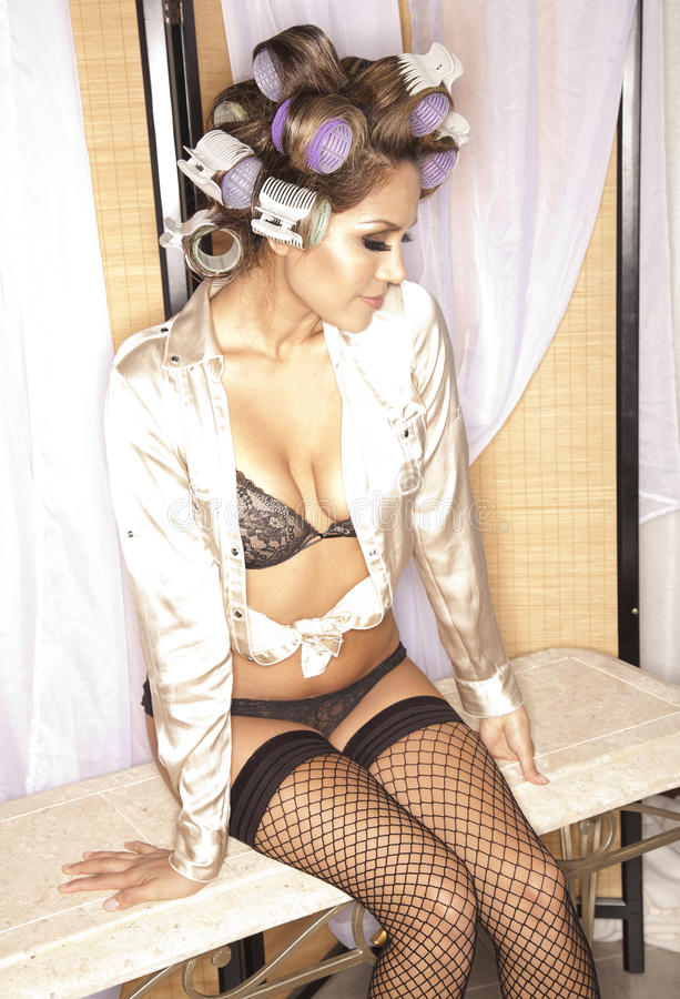 Woman In Lingerie And Curlers Royalty Free Stock Photo