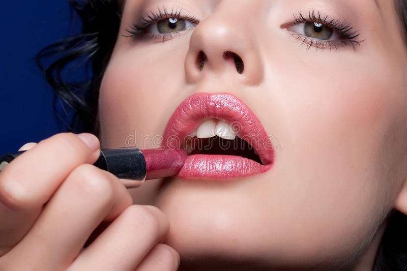 Woman And Lipstick royalty free stock image