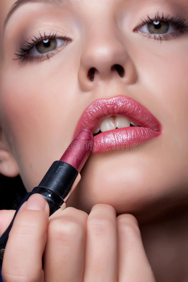 Woman And Lipstick stock photos
