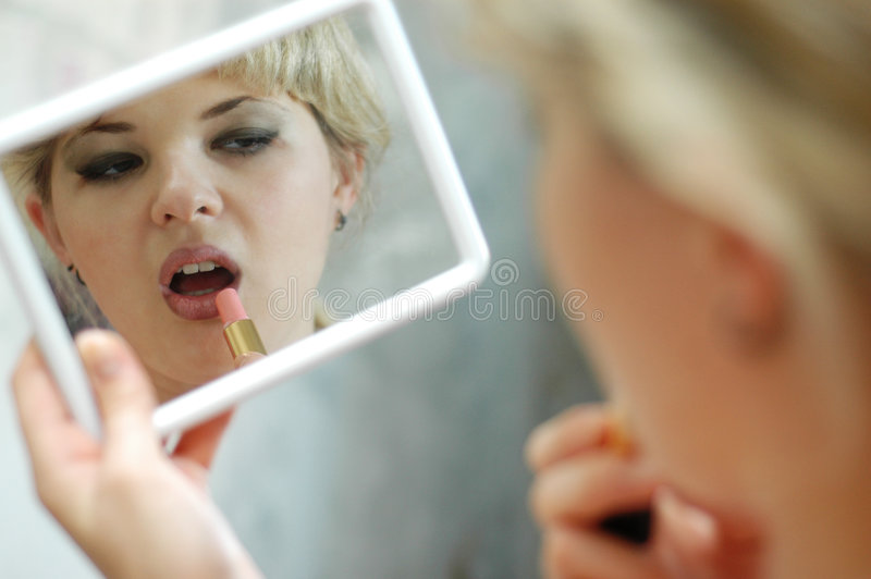 Download Woman With Lipstick And Mirror Stock Photo - Image: 5846316