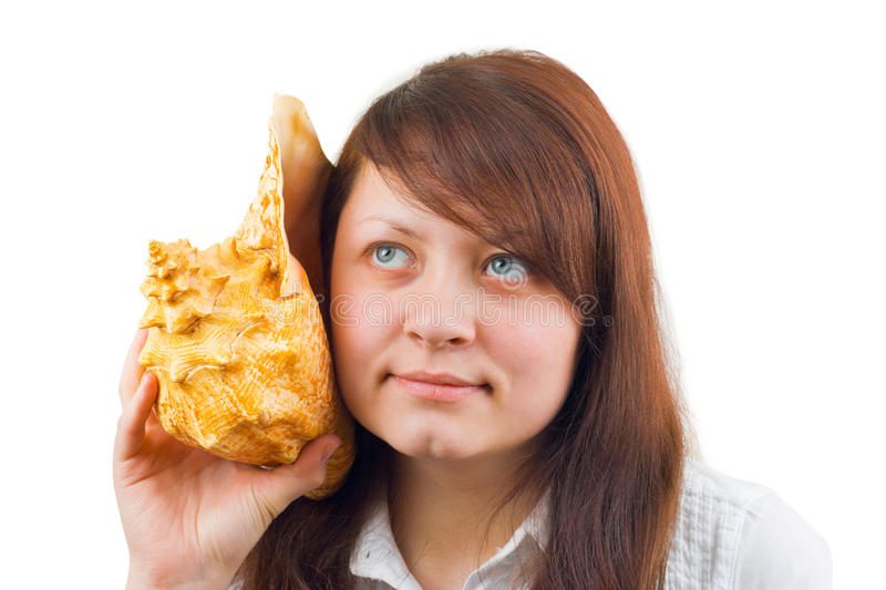 Woman Listening Big Conch Stock Photo