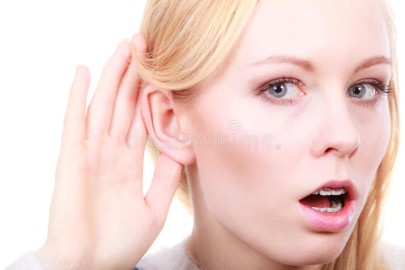 Download Woman Listening Carefully With Hand Close To Ear Stock Photo - Image: 83714394
