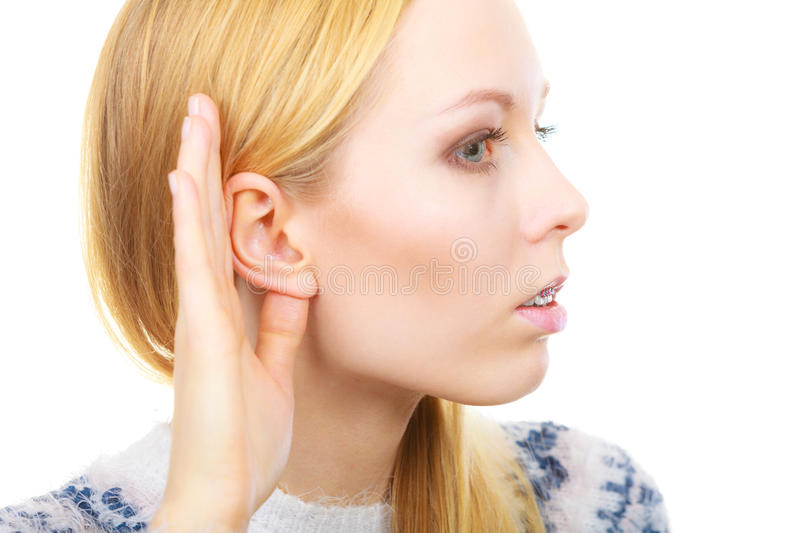 Woman listening carefully with hand close to ear. Rumors, gossip and gestures concept. Blonde woman listening carefully with hand close to ear stock photos