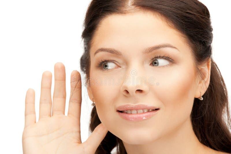 Woman listening gossip stock images