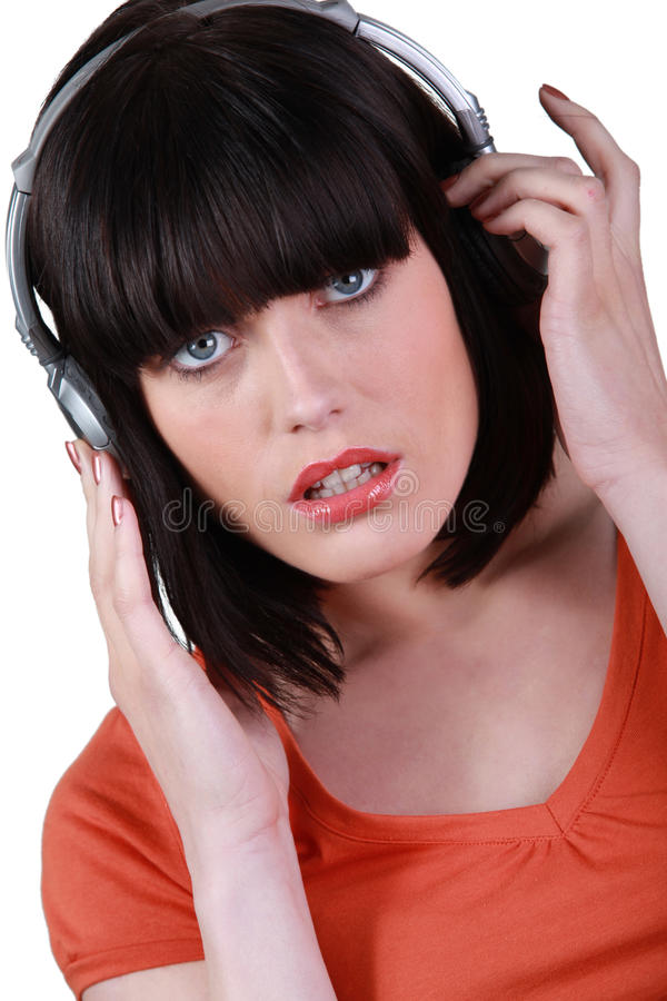 Download A woman listening music stock image. Image of headphones - 27390543