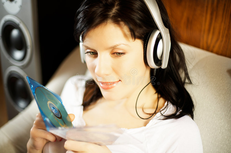 Woman listening music in headphones royalty free stock photo