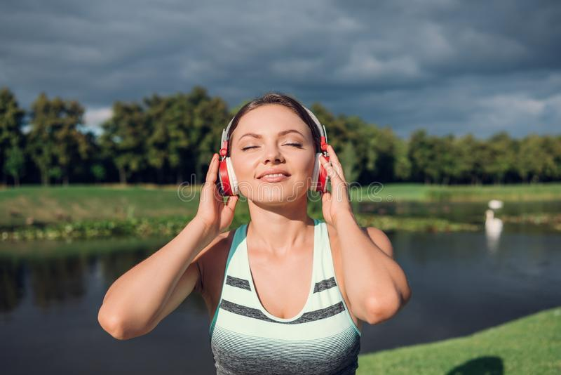Woman listening music in headphones stock images