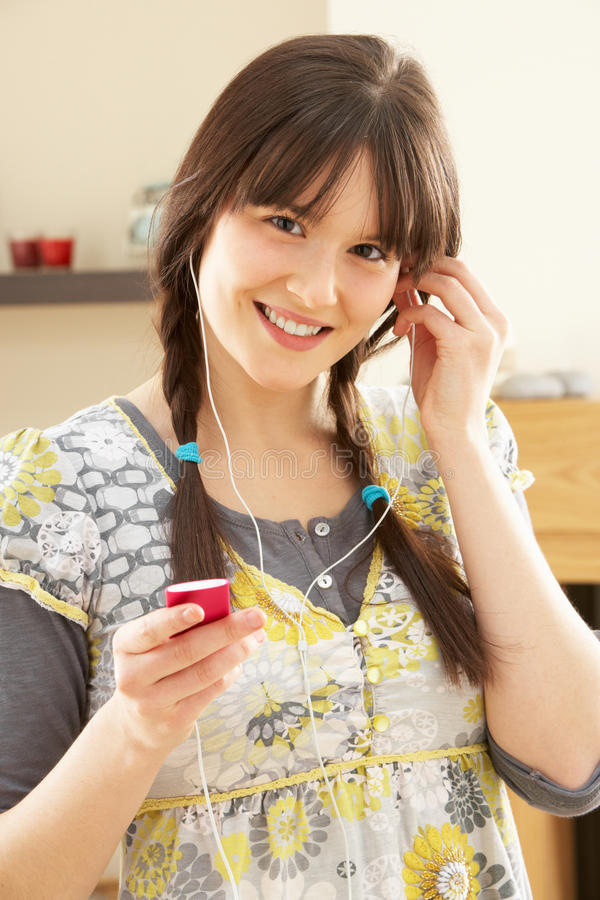 Woman Listening To MP3 Player On Headphones royalty free stock image