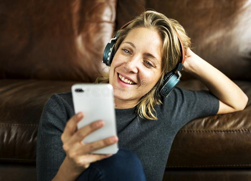 A woman listening to the music royalty free stock photo