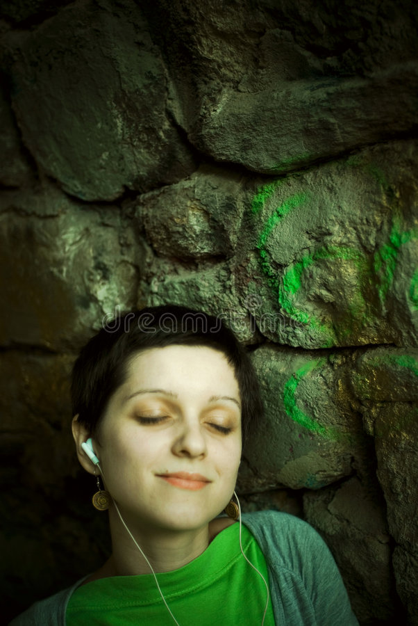 Woman listening to music stock photo