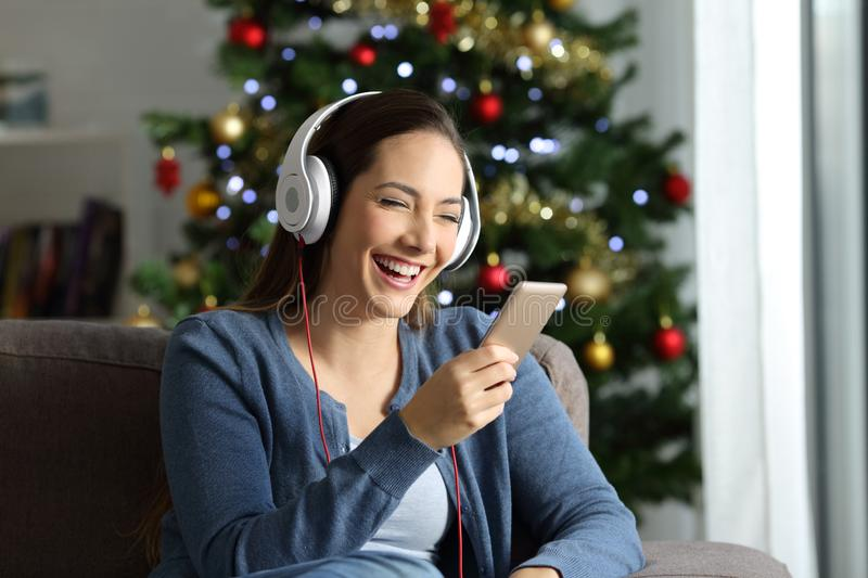 Woman listening to music on christmas royalty free stock photos