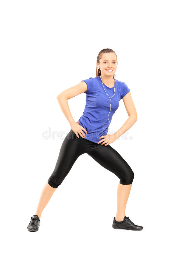 Woman listening to music and exercising stock images
