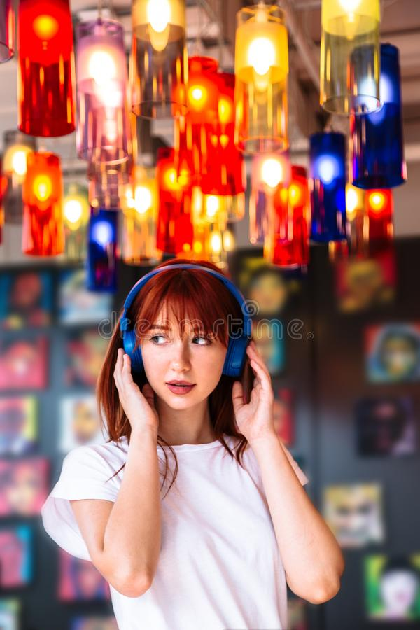 Woman listening to music in headphones in cafe stock photos