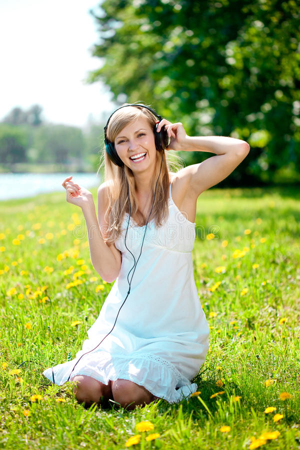 Download Woman Listening To Music On Headphones O Stock Image - Image: 25447873