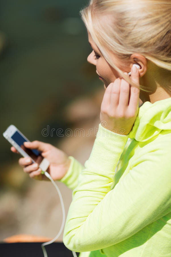 Download Woman Listening To Music Outdoors Stock Photography - Image: 34769962