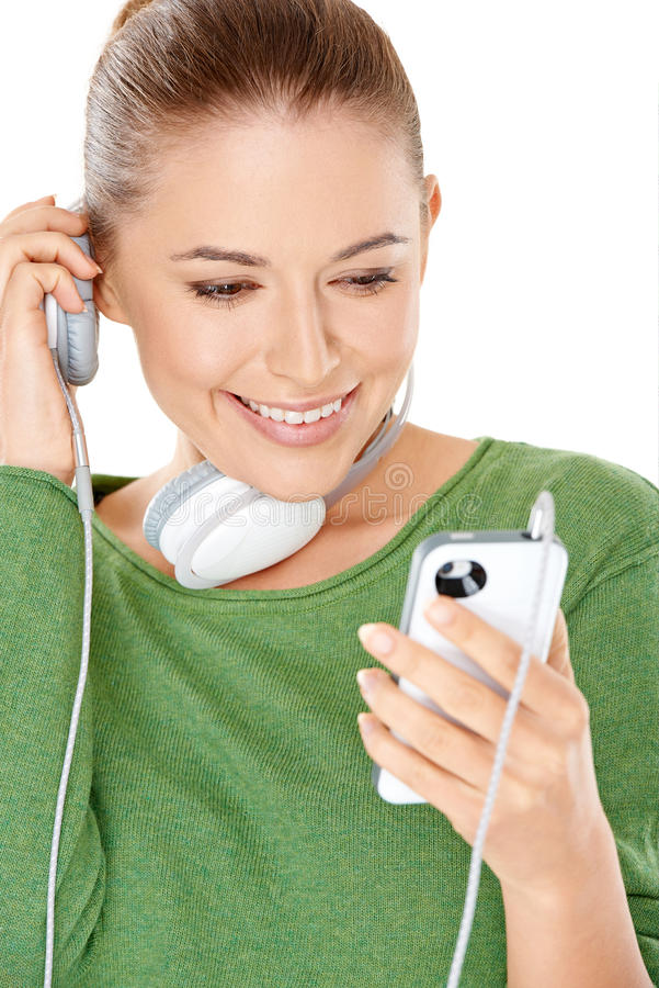 Woman listening to a new music download royalty free stock images
