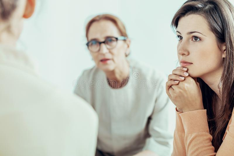 Woman listening to therapist during training for businesswoman in the office. Concept royalty free stock photo