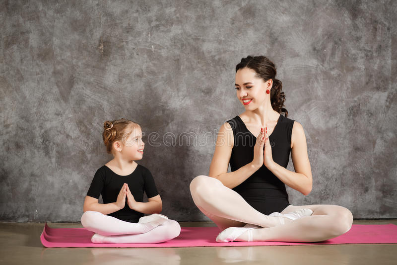 Woman with little daughter exersizing together royalty free stock images