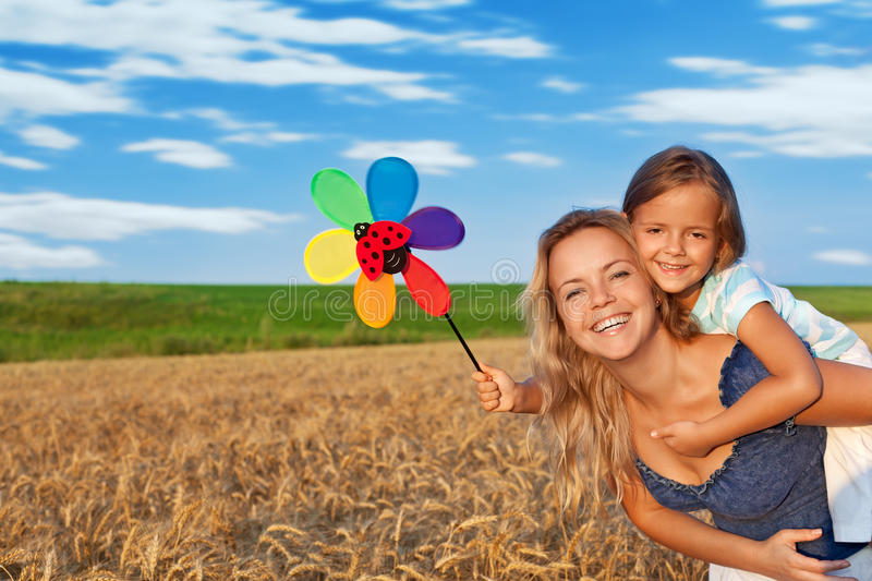 Download Woman And Little Girl Having Fun Outdoors Stock Photo - Image of blond, outside: 20551750