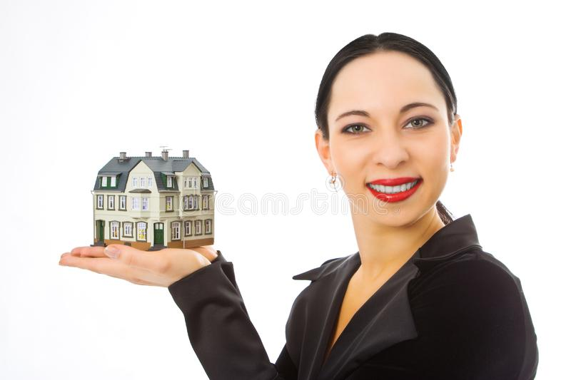 Woman with little house on hand stock photography