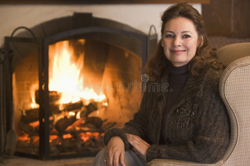 Woman in living room smiling stock image