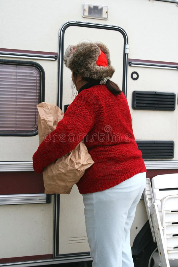 Woman living in a trailer stock images