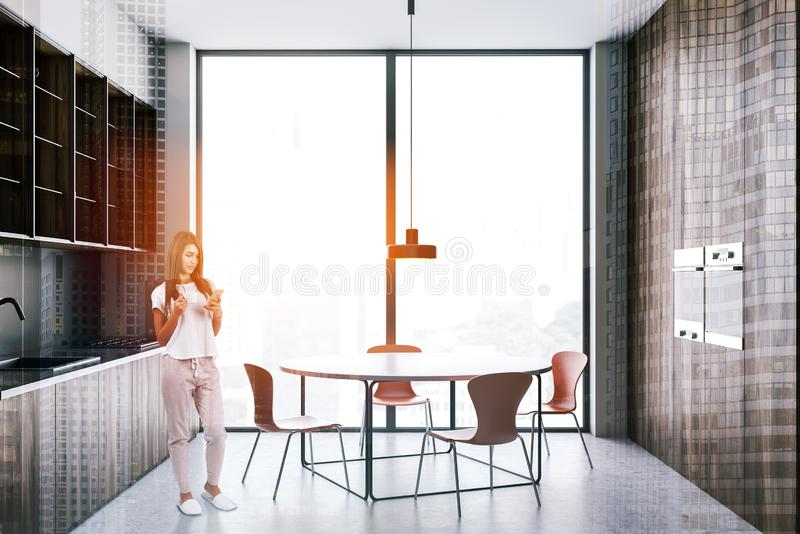 Woman in loft wooden kitchen with table royalty free stock image