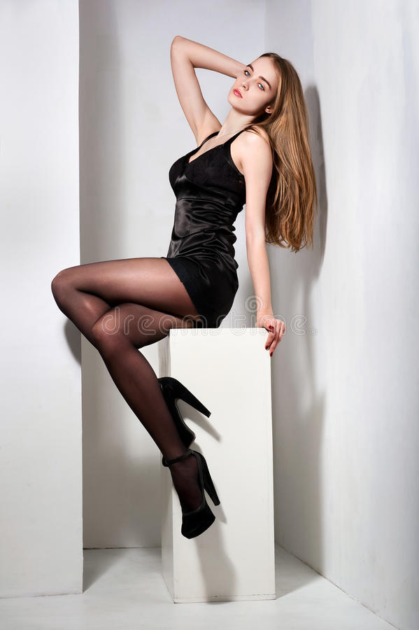 Woman with long beautiful hair and legs posin. G at the studio stock photos